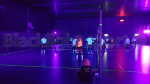 Blacklight volleyball sport event